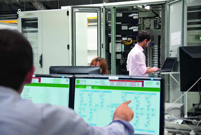 PACiS (front) is a Digital Control System for Substation Automation from Schneider Electric