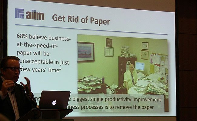 Paper slows down digital transformation - business at the speed of paper is unacceptable - also in manufacturing where it still is a MES software market driver - picture J-P De Clerck