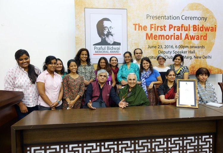 PARI is a diverse group of volunteers with various skills and languages, distributed geographically. Here PARI volunteers receiving an award from historian Romila Thapar.