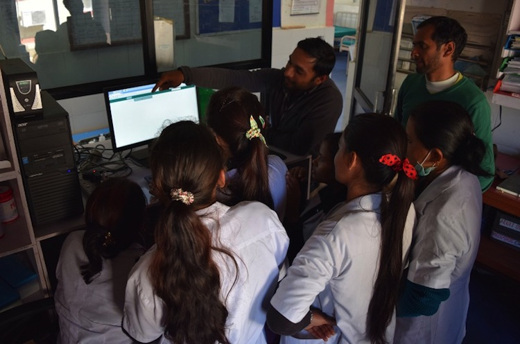 Our engineer, Anant, conducting EMR trainings with our nurses. Photo Credit: Possible