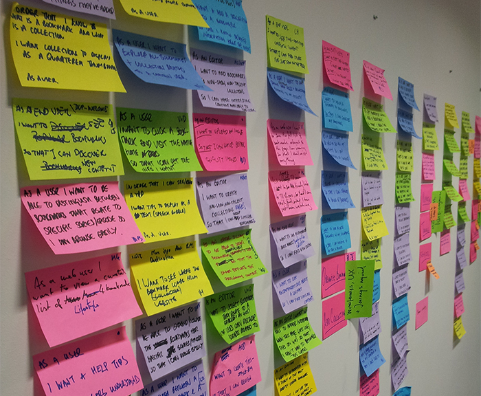multi-coloured post it notes lined up on a wall