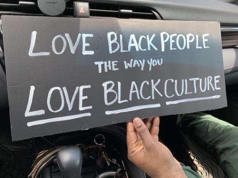 photo of sign saying love black people like you love black culture